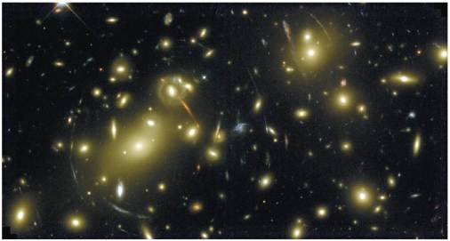 Gravitational lensing of distant galaxies by a closer galactic cluster. Observed by Hubble Space Telescope.